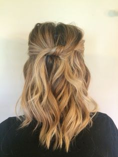 Medium length beach waves. Top pieces knotted and pinned.