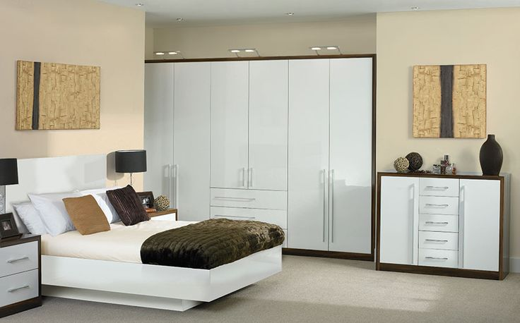 Bella High Gloss White Venice Bedroom  Brand: Bella  Update your bedroom with this fresh and contemporary Bella high gloss white Venice bedroom furniture collection. Not only is it the perfect storage solution for all your things, it maximises your storage space potential by being made to measure, and it looks great too!