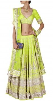 Featuring an exquisite lime green raw silk lehenga with traditional gota pati embroidery.