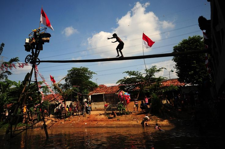 A child walked on a pole installation that will be used in a competition as part of Indonesia Independence Day celebrations in Jakarta, Indonesia, Friday. (Zulkarnain/Xinhua/Zuma Press)