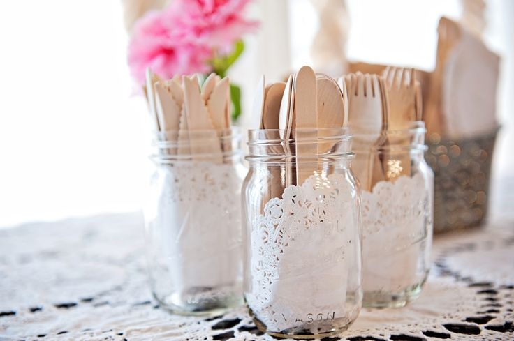 Mason jars holding the wooden utensils - I have seen doilies tied to the outside of the mason jars but actually putting them in the jars adds a nice touch.