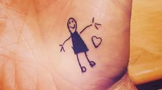 Get a tattoo with your child's drawing? What it means: You're an artsy parent who values your child's vivid, seemingly infinite imagination. Some days, you might even see yourself as a big kid. #tattoos #whattoexpect | whattoexpect.com