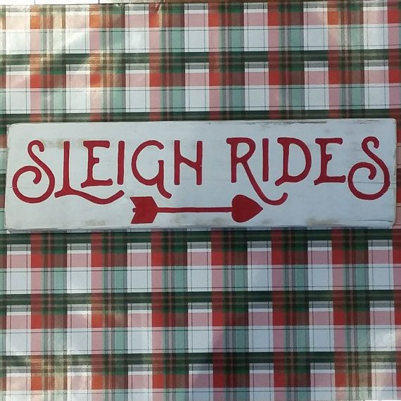 A cheery hand painted Christmas sign, with the words Sleigh Rides, and underneath an arrow, painted in red on a white distressed background. The wood is naturally weathered barn board that has been repurposed into beautiful home decor. The wood is approximately 6 x 16 x 0.5.  The sign is designed and painted by myself in my home in Ontario, Canada. Each piece is unique. My signs are fully customisable, so please get in contact if you would like something designed for you.  Free delivery is…