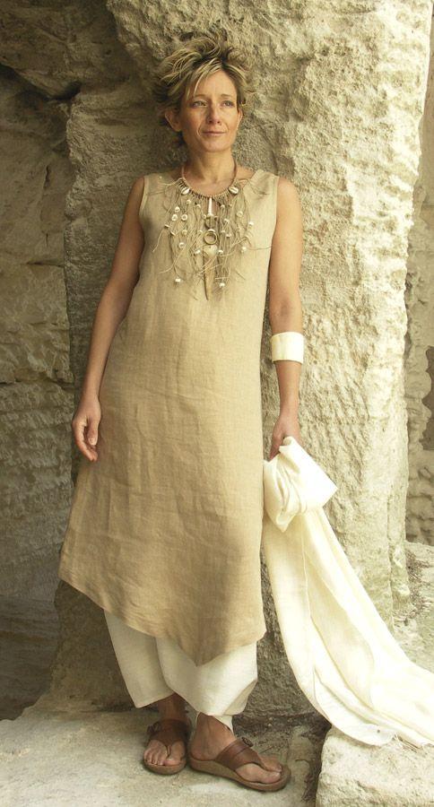 Beige linen tunic worn over a white sarouel