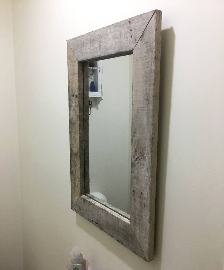 Mirror surround made from an old pallet, with old rusty nails and knots, really pleased with outcome.