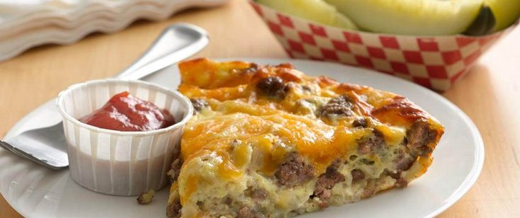 Impossibly Easy Cheeseburger Pie - Bake the magic of a cheeseburger in pie form—it's impossibly easy! Use ground sausage /bacon and it becomes breakfast!
