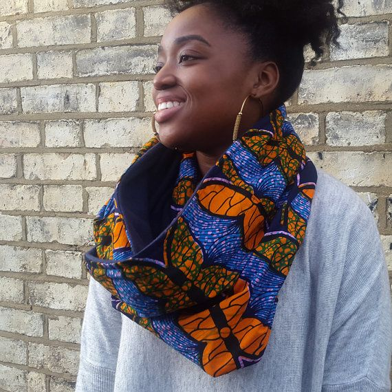 A snood scarf giving you the best of two worlds. With an African print on one side for a funky and colourful pattern and a soft fleece on the other for