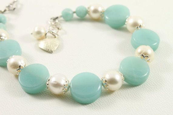 I designed and made this lovely bracelet with round Amazonite discs, freshwater pearls and beautiful Silver caps finished with a Silver lobster clasp