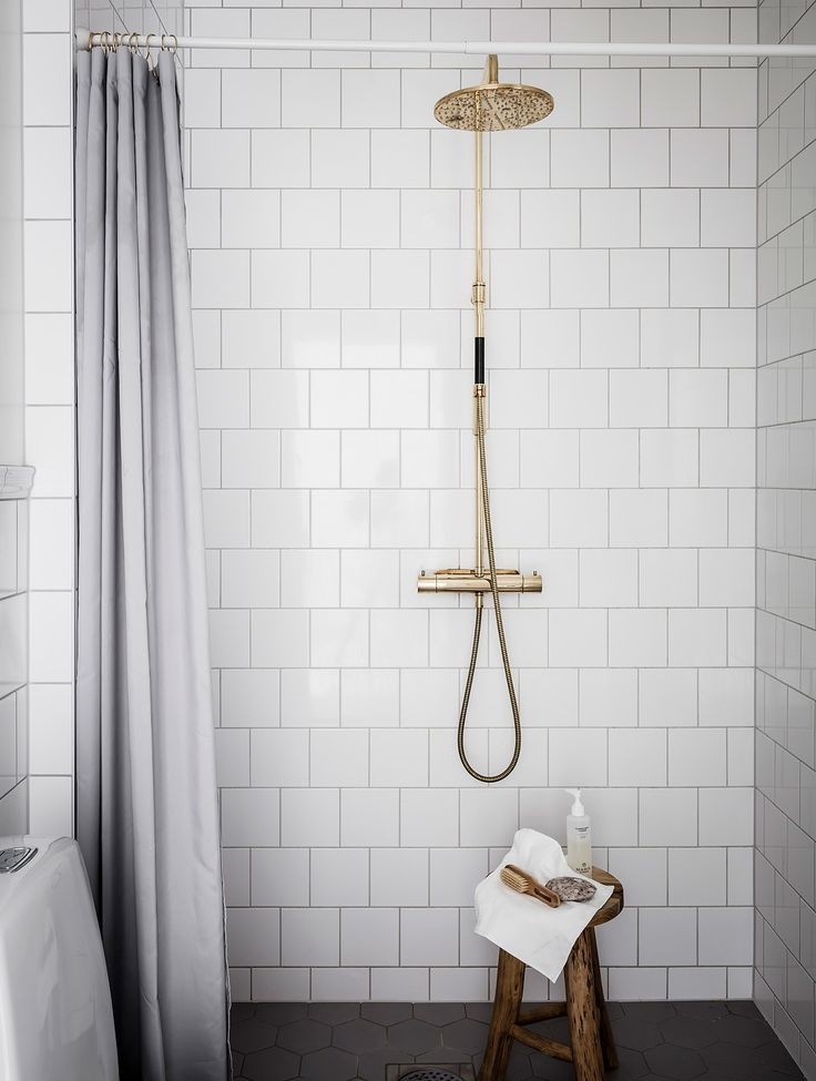 my scandinavian home: brass shower, wood stool and grey shower curtain. Photo Anders Bergstedt for Entrance.