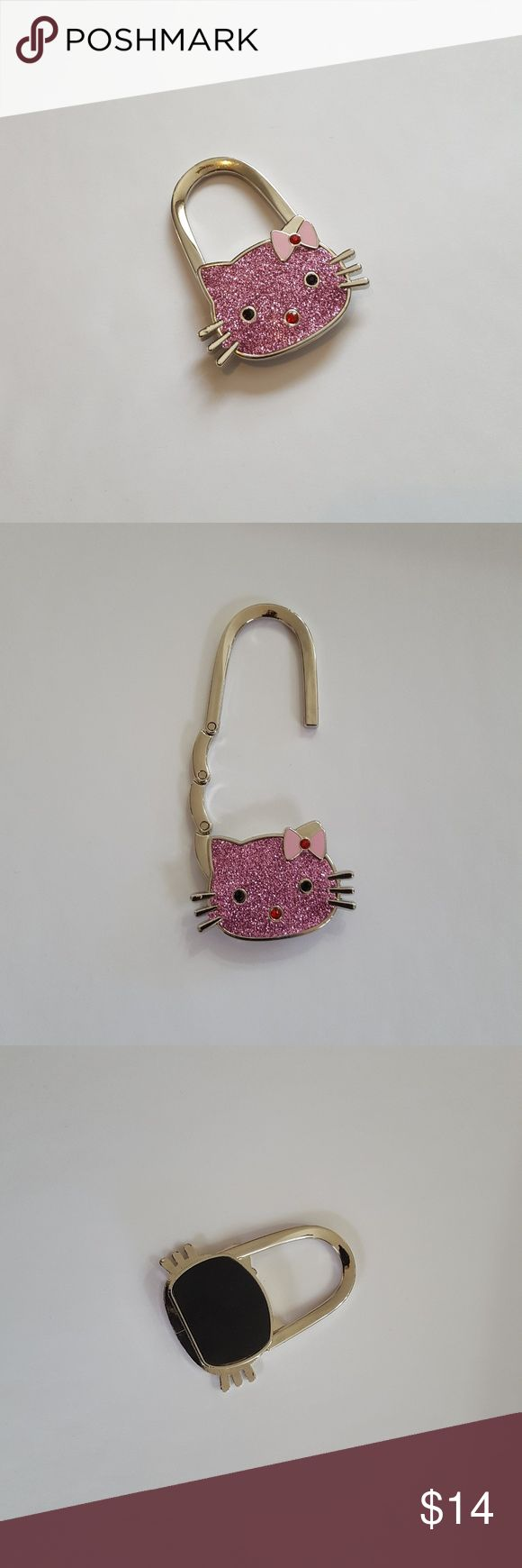 Hello Kitty Folding Purse Hook Hello Kitty folding purse hook. A must for your nice handbag or purse. Conveniently fits in your purse for use at restaurant tables, bars or restrooms to keep your purse clean. Accessories