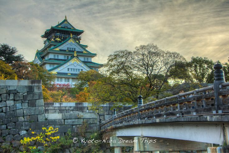 """Osaka, Japan""~~Toyotomi Hideyoshi's Castle and Bridge to Toyotomi Hideyoshi's Castle in Osaka, that leads to the Ōtemon Gate (大手門) . This bridge connects the Yamazato-maru Bailey and the Ni-no-maru (outer Bailey). ""Gokuraku"" is a Buddhist word meaning ""the world of peace,"" the name could be associated with the Osaka (Ishiyama) Hongan-ji Temple, which was located on this site before Osaka Castle was built by Hideyoshi."