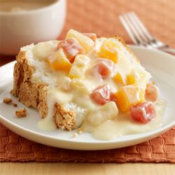 Tropical Fruit Sauce over Angel Food Cake ... An easy angel food cake topper recipe combines tropical fruit with vanilla pudding for a simple dessert that only takes five minutes!