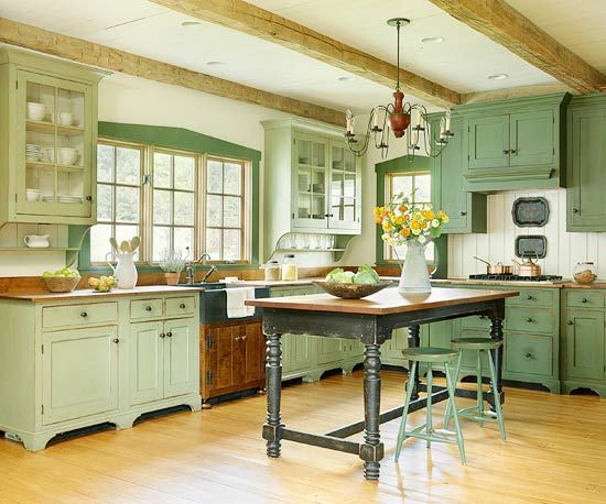 Farmhouse Charm : Antique, furniture-style cabinets and a farm table island. Love this style.