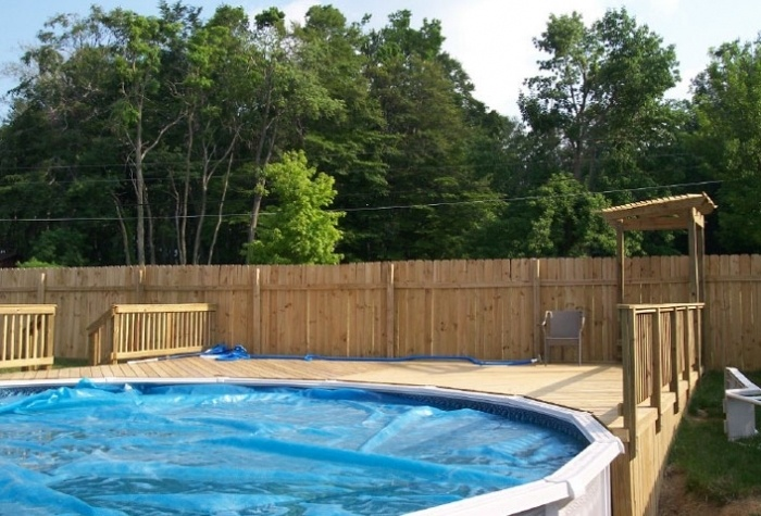 The Deck Makes The Above Ground Swimming Pool More