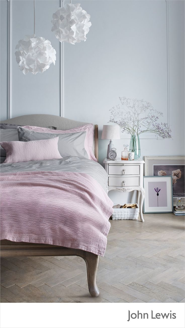 Give your vintage-style sleep sanctuary a modern twist with statement lighting – channel the look with these Lotus Flower pendant shades. Warm throws and cushions in soft pastels make your bedroom feel cosy and inviting. Create an easy update by propping paintings and framed prints against the wall for a chic Parisian apartment look.