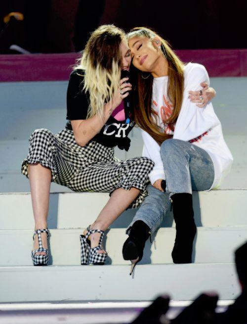 arigrande-edits: Ariana Grande and Miley Cyrus performing at