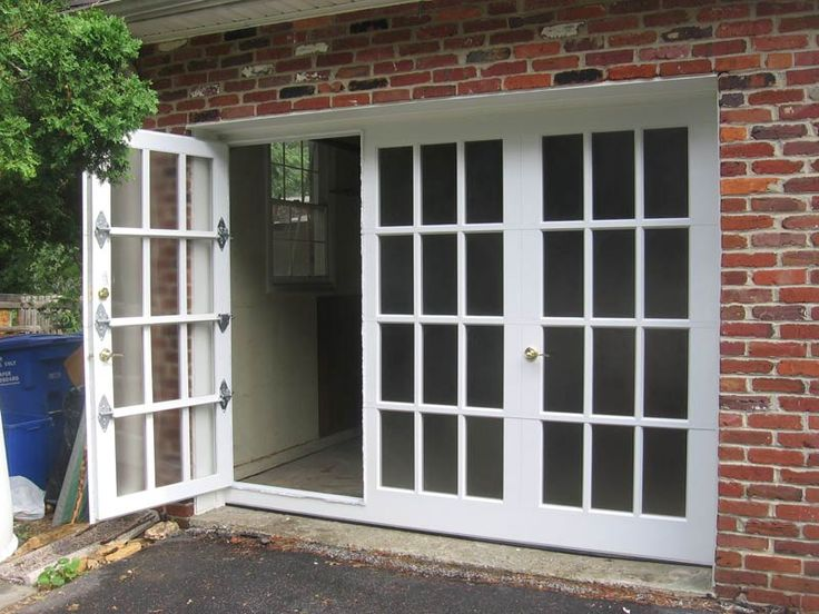 French Door Style Garage Door With Pass Through Door.