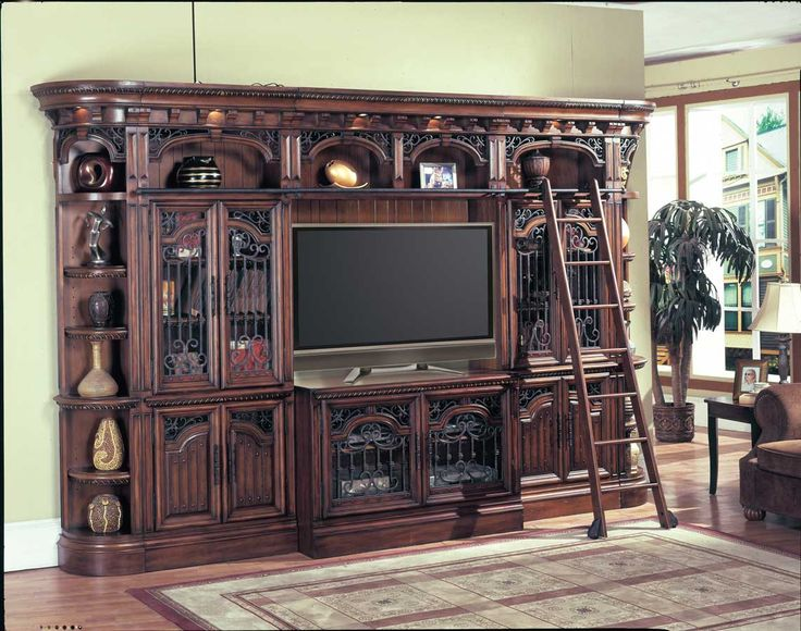 Parker House Barcelona 32in Glass Entertainment Center - This library system is fully customizable. You can modify the configuration below or contact us to customize. The Barcelona Library Wall Collection is designed in Spanish Revival style and finished in dark red walnut Stain with hand wiped overglaze. This wall collection offers the mixed function of Entertainment center, home office, or bookcase wall.