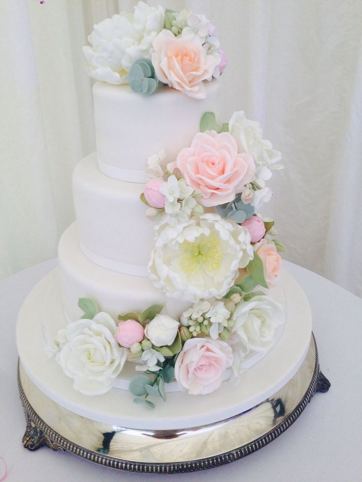 Lots of sugar flowers for this wedding cake... Roses, peonies and buds, eucalyptus and hydrangeas... in soft peaches and dusky pinks.. all hand made over a period of days!