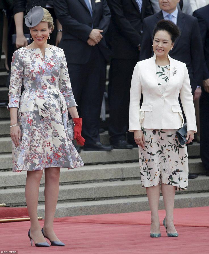 Smart: Another vibrant print dress was chosen as she meets Chinese President Xi Jinping's wife Peng Liyuan in Beijing