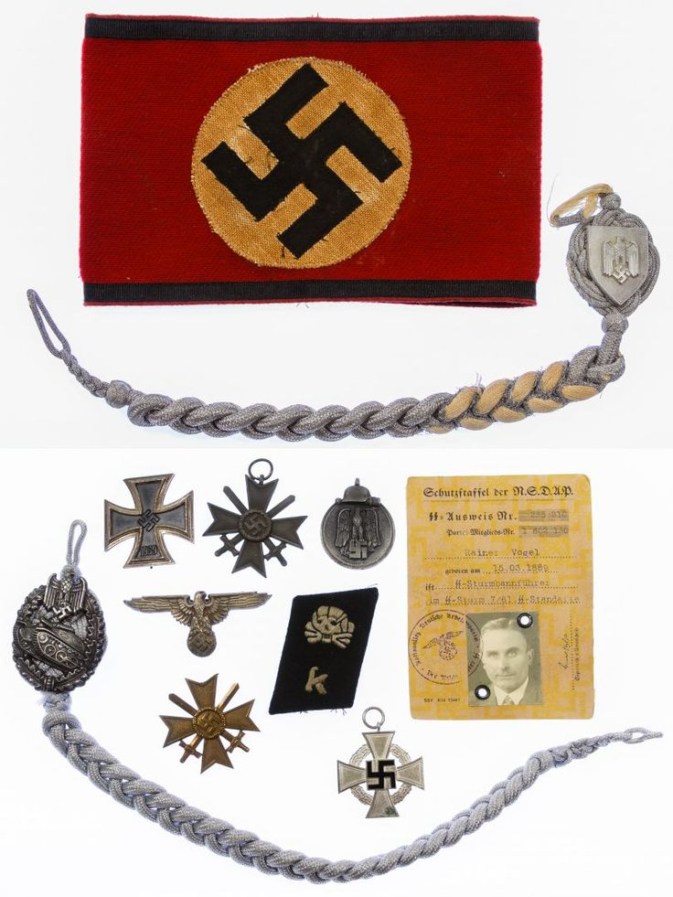 Lot 287: World War II German Medal, Arm Band and Patch Assortment; Including an Iron Cross, War Merit Crosses, a possible replica red wool arm band, a 1939 pass, a Russian Front medal, a possible replica SS Totenkopf collar tab and (2) braided portapees with medals