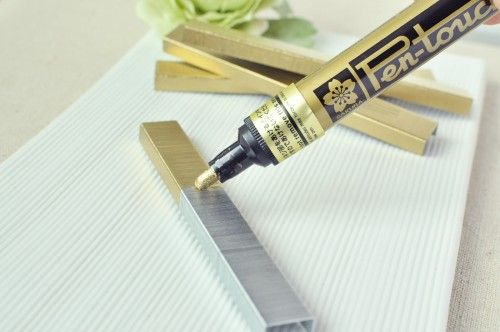 A paint pen can change your staples for those special items like invitations and programs. Good idea!: Diy Ideas, Gold Paintings, Diy Gold, Good Ideas, Gold Staples, Permanent Markers, Colors Staples, Special Items, Paintings Pens