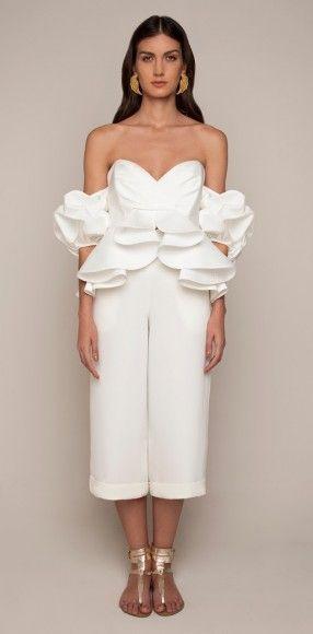 From distinctive necklines to dramatic volume, Johanna Ortiz's designs epitomize a festive yet elegant style.
