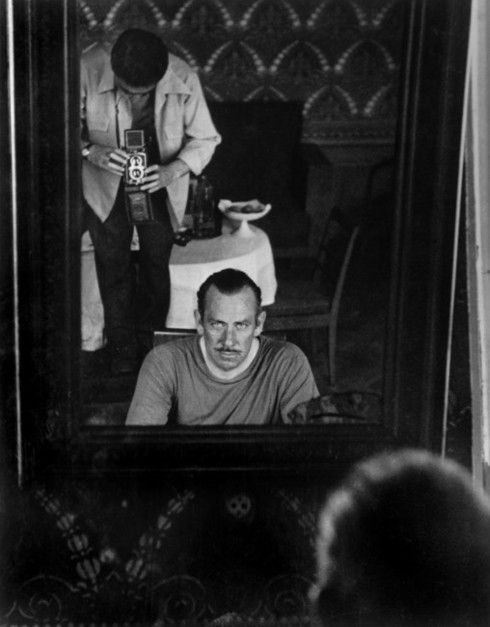 USSR. 1947. Moscow. Hungarian born photographer Robert CAPA focusing his Rolleiflex in the mirror.