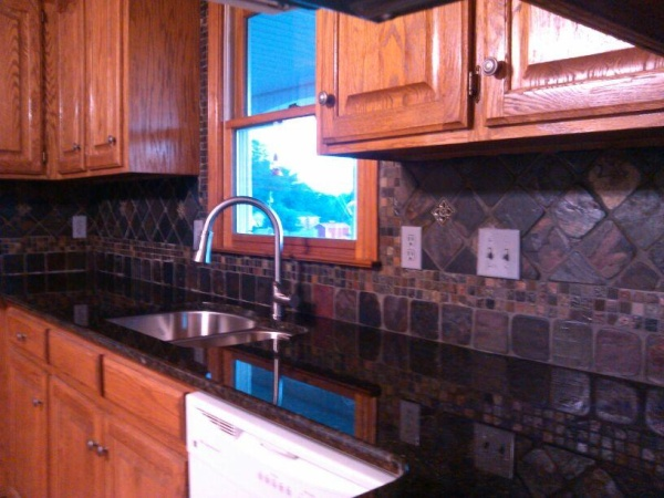 Alder Cabinets Kitchen Blue Valance Uba Tuba Granite Countertops With Slate Tile Backsplash ...