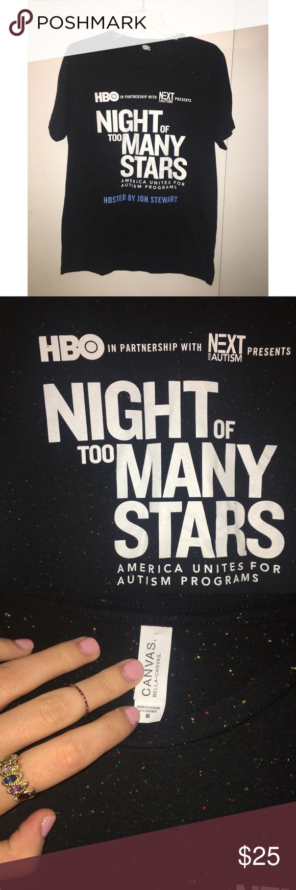 """Official tee from HBO Event hosted by Jon Stewart! Rare and never worn!! Black t-shirt with multi-color speckles that look like """"stars"""" 🌟⭐️⭐️ If you have HBO, this LIVE benefit raised money for Autism awareness and programs that help the families affected. You won't snag this unique official tee from anywhere else! Awesome cause and looks cool! Size medium. Tops Tees - Short Sleeve"""