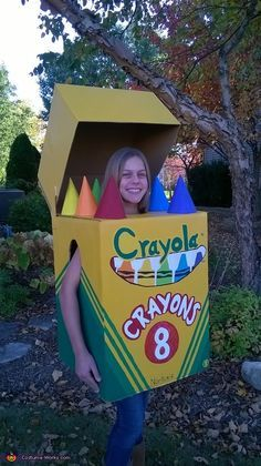 John: My 12-year old daughter, Dana, is wearing this costume. She made this costume mostly by herself, with a little help with cutting the boxes. Besides that, she thought of this...