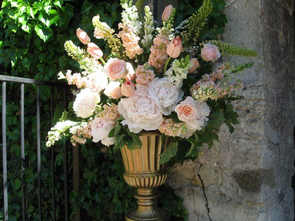 Urn arrangement in shades of blush and ivory -- Peonies, French Tulips, Roses, Stock, Snap Dragons, Tuberose.