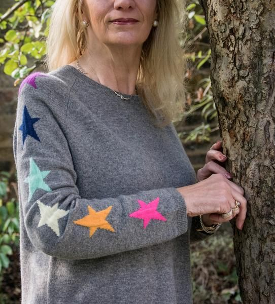 Luca Cashmere Sweater - 100% cashmere grey jumper with multi-coloured stars down the arm by WYSE London at the-Bias-Cut.com. Designer unique luxury cashmere