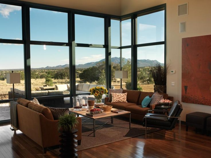 Large windows covering an entire wall give room to a stunning mountain view, as well as an outdoor patio area.