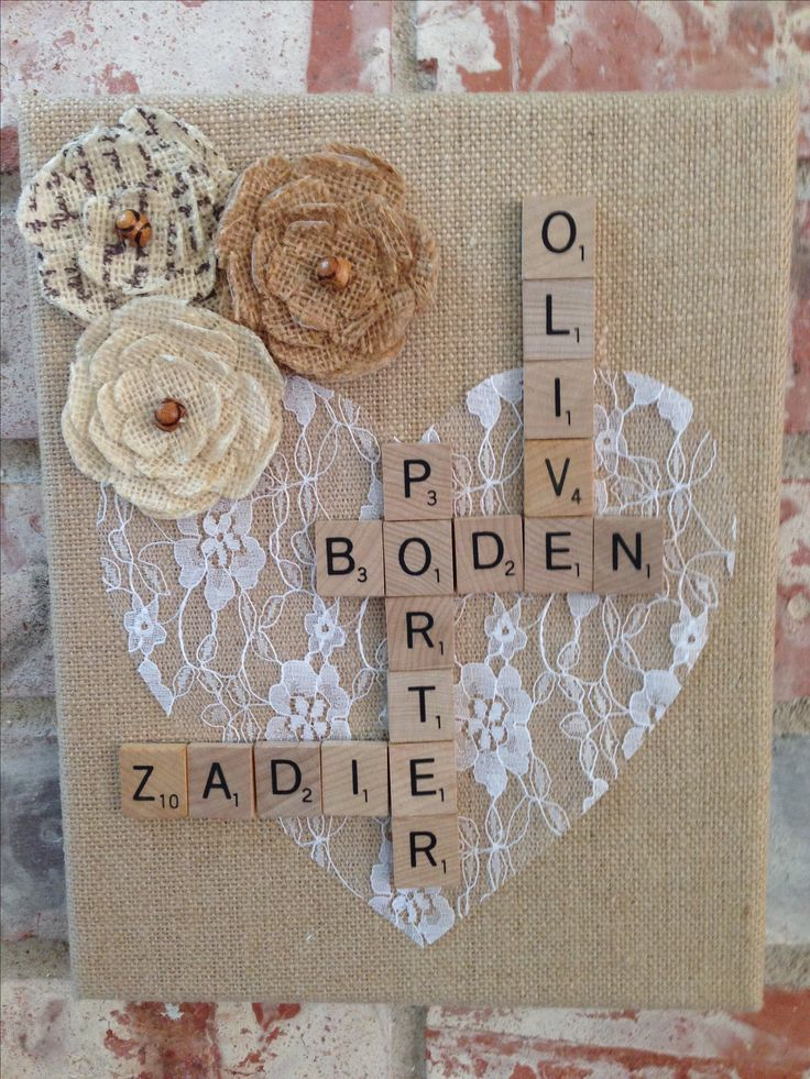 Cut heart from lace, glued heart, scrabble tiles and flowers on canvas wrapped in burlap