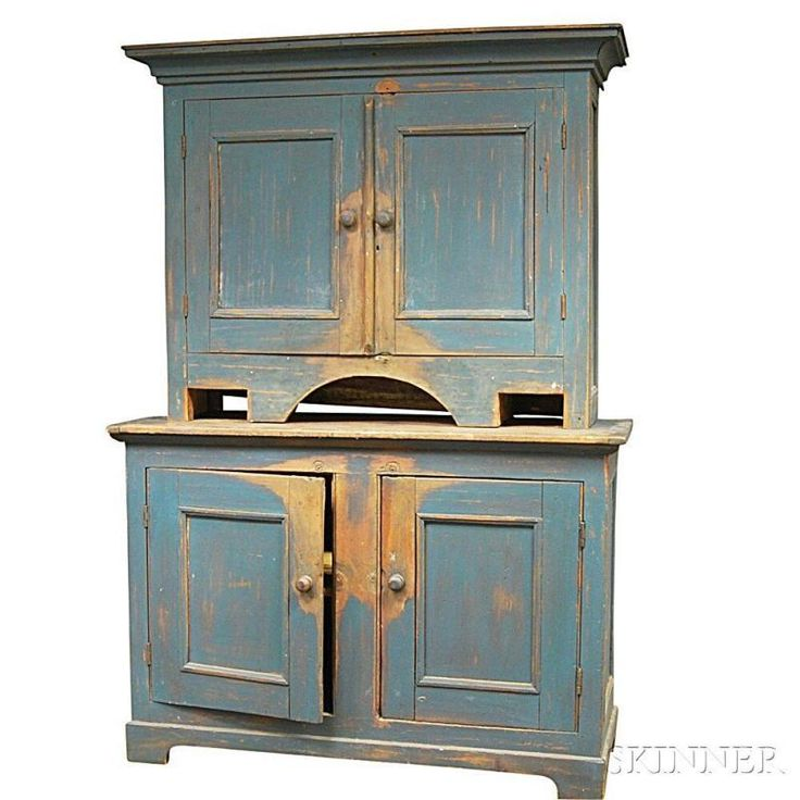 Blue-painted Two-piece Step-back Cupboard, America, 19th century, the upper section with cove-molded cornice over two paneled, hinged doors and central arched support, the lower section with two hinged, paneled doors, raised on bracket feet, blue over an earlier salmon paint, ht. 80 1/2, wd. 56 3/4, dp. 22 1/2 in.