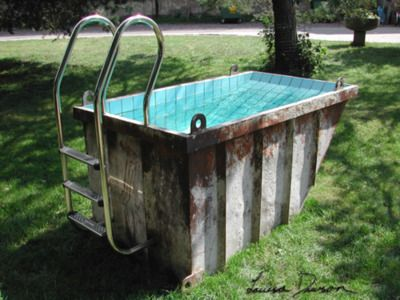 trash dumpster pool.we gotta do this sissy, its probably WAY cleaner than that pool we went to ewww lol
