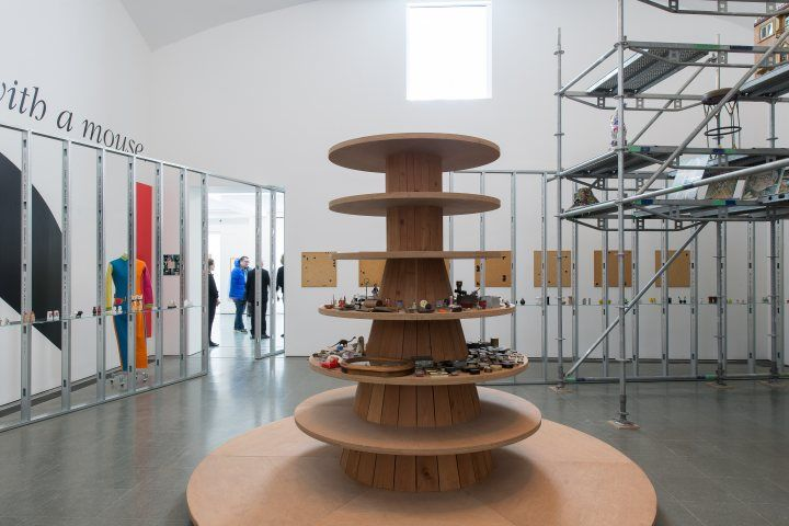 Haim Steinbach: once again the world is flat. 5 Mar 2014 to 5 May 2014 at Serpentine Gallery | Serpentine Galleries . Displayed on the metal structures that builders use for putting plasterboard onto.