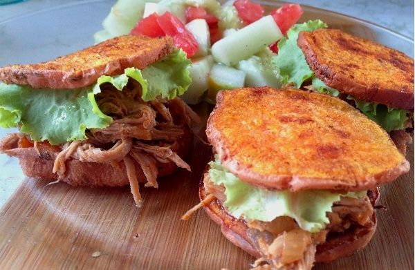 Paleo pulled pork sliders - Whole30 compliant slow cooked pulled pork served on crispy sweet potato patties.