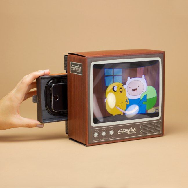 Televisions have become a bizarre technological arms race. 1080i 1080p WIDER THINNER CURVIER LCD LED LSD 3D 4D 5D The Smartphone Magnifier has returned this