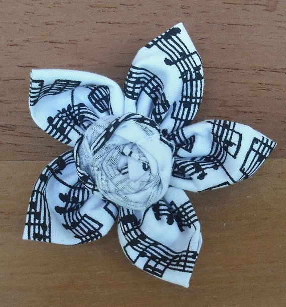 Music flower Hey, I found this really awesome Etsy listing at http://www.etsy.com/listing/162156391/five-point-fabric-flower-black-and-white
