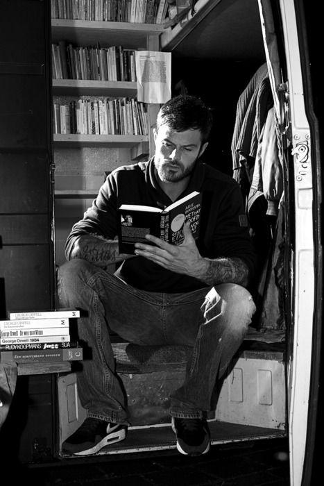 Josh Duhamel engrossed in a book.