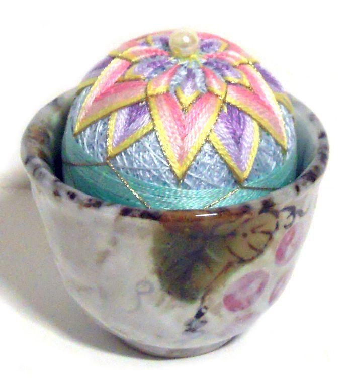 mint color tea cup pincushion