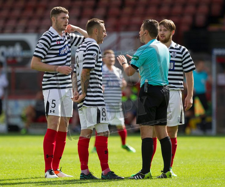 Queen's Park's players discuss a point with referee Andrew Dallas during the Betfred Cup game between Partick Thistle and Queen's Park.