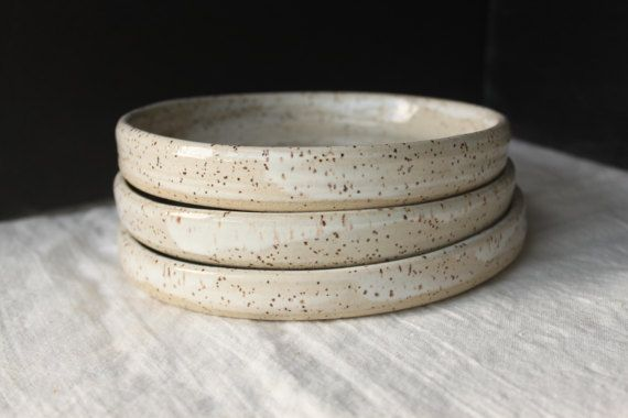 This contemporary side plate is handmade on the potters wheel from tan coloured speckled stoneware clay and glazed a soft white. The plate is 6 in diameter and 3/4 tall. The set includes 4 pieces.  The plate is food, dishwasher and microwave safe. It is perfect for lunchtime yummies or coffee snacks!  As each piece is handmade there may be some minor variation in size and finish. This is part of the joy of artisan pottery.  If youd like a custom message on the underside of the piece, jus...