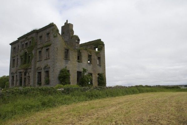 Abandoned Mansions, Ireland.  County Galway in Ireland is known for its abandoned mansions that pop up seemingly in the middle of nowhere. Pictured here is Tyrone House, one of the most famous. It's surrounded by a fence and signs warning visitors not to approach, but there's no one around for miles to enforce this.