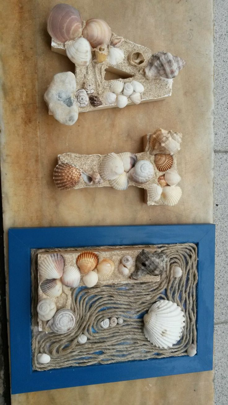 Letters decorated with sand, shells and string