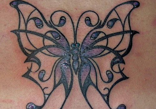 Gorgeous Tribal Butterfly to cover up lower back tattoo