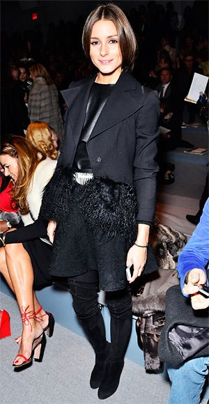 Olivia Palermo attended Dennis Basso's show wearing a structured black Armani fur trimmed jacket over a leather top with a matching skater skirt and over the knee boots.