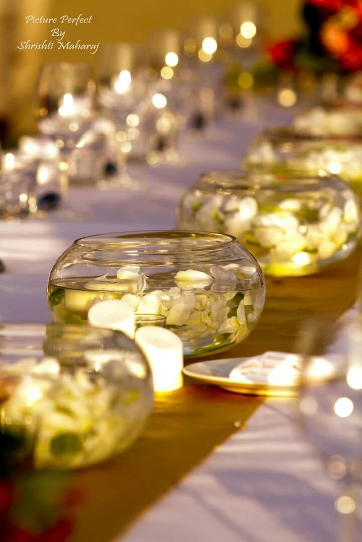 Table centerpiece. Flowers & candles in water
